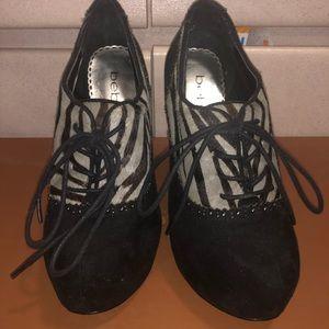 Bebe black heels with zebra print!